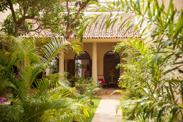 Beautiful garden entrance to The Mango House