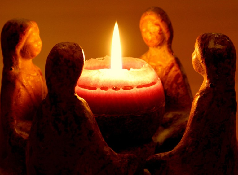 Burning candles are part of the furniture in zen Same Same in Angersm