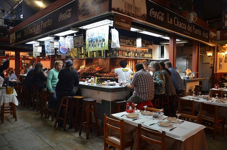 People eating at Mercado del Puerto, Montevideo, Uruguay