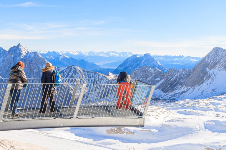 Group of people enjoying fresh air on Zugspitze peak 2962m high