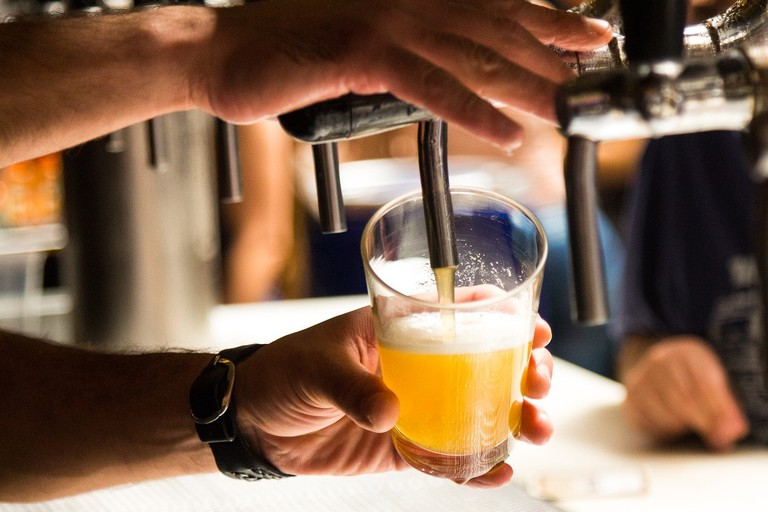 Brazilians drink beer in small glasses