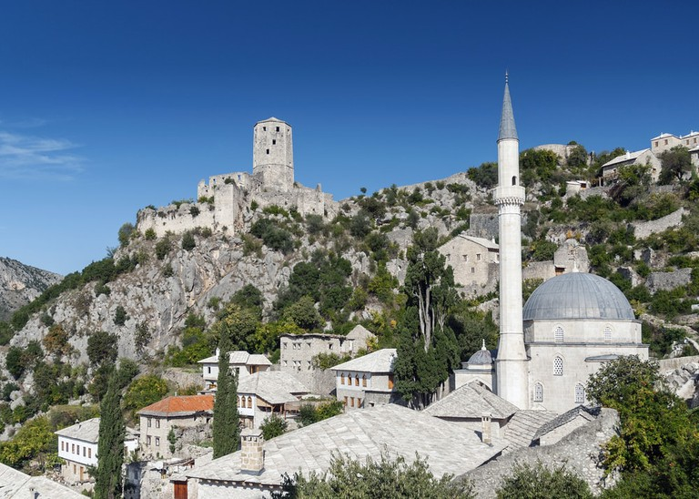 Scenic view of Pocitelj village traditional old architecture buildings and mosque |© JM Travel Photography /Shutterstock