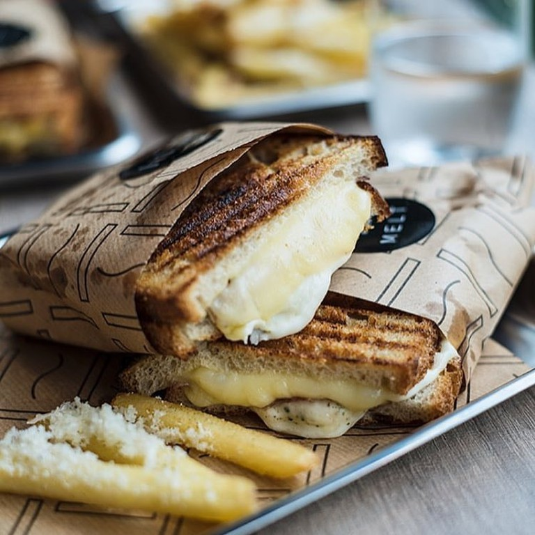 Melt grilled cheese sandwich with mozzarella and parmesan