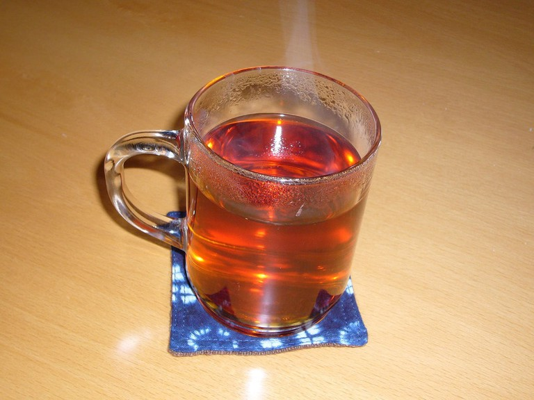 A steaming hot glass of tea