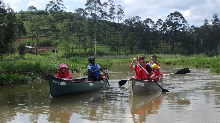 "Canoeing on the Mukungwa River | <a href=""https://minitravellers.co.uk/canoeing-in-rwanda-with-kids/"" target=""_blank"" rel=""noopener"">Courtesy of Mini Travellers</a>"