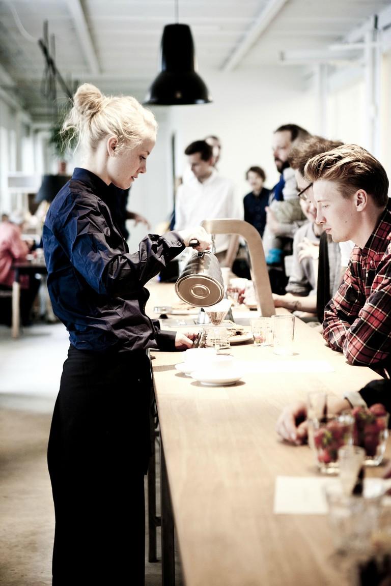 Pouring coffee copenhagen cafe