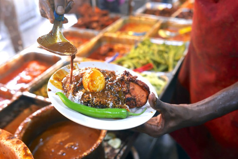 Nasi Kandar is a popular self-service dining in Malaysia