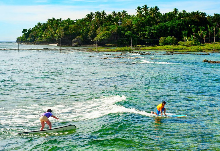 Surfers in Siargao