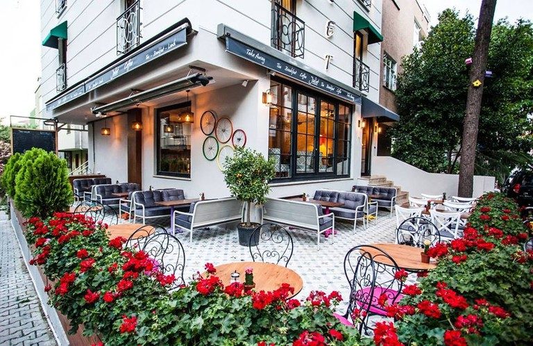 The beautiful outdoor seating area at Juliet Rooms & Kitchen's cafe   © Juliet Rooms & Kitchen