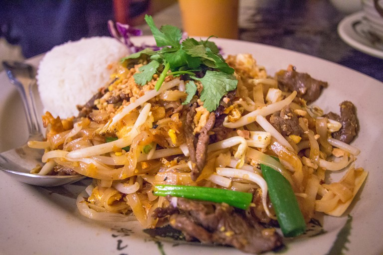 Enjoy a delicious plate of pad Thai