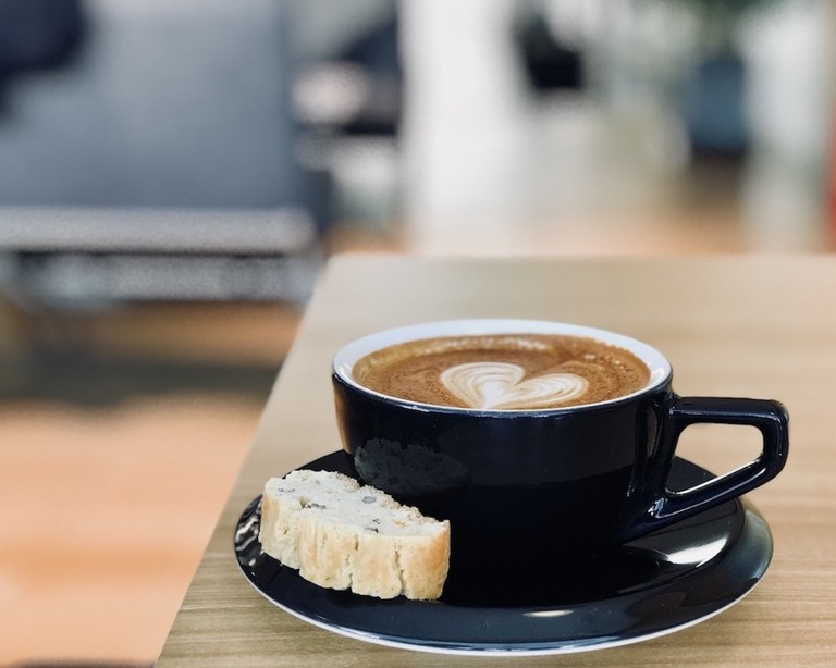 A flat white and piece of biscotti make a perfect pairing at Bracket