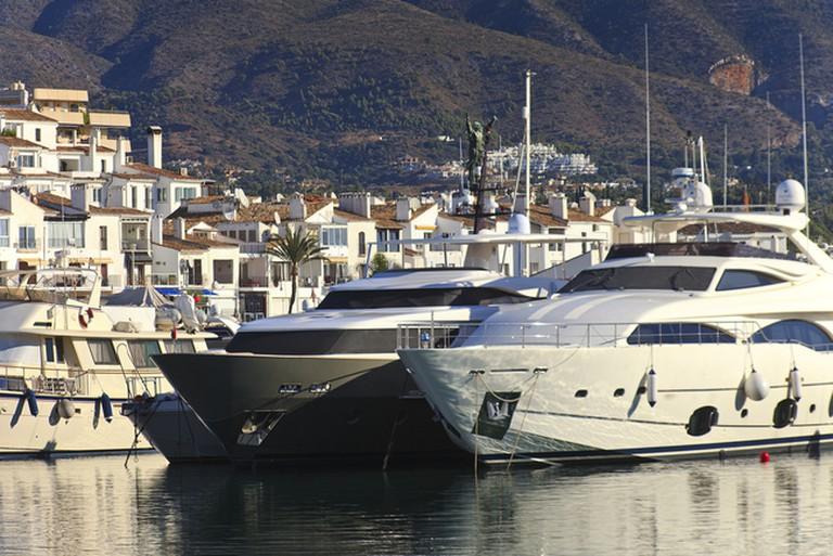 Sinatra Bar overlooks yachts moored in the marina of Puerto Banús