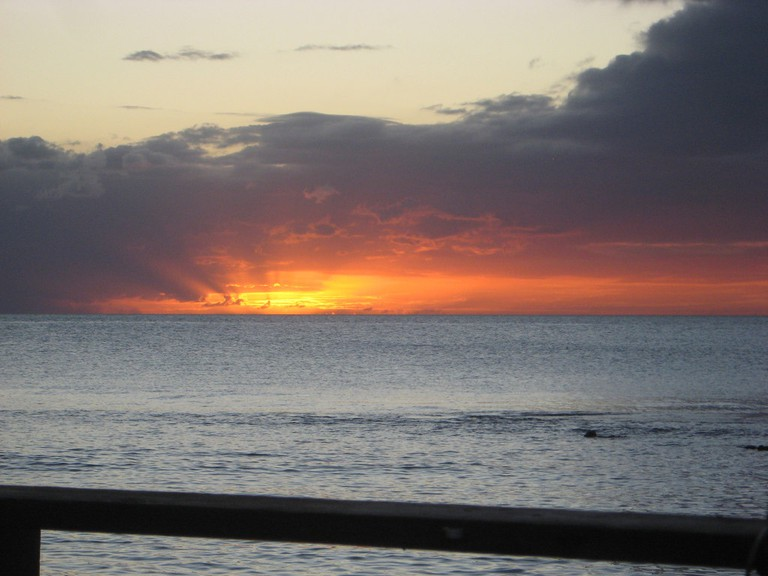 The Caribbean sunset from the deck at Bamboleio