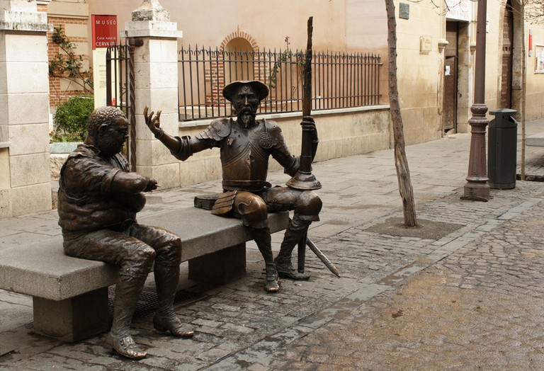 A statue of Don Quijote and Sancho outside of the Cervantes Museum