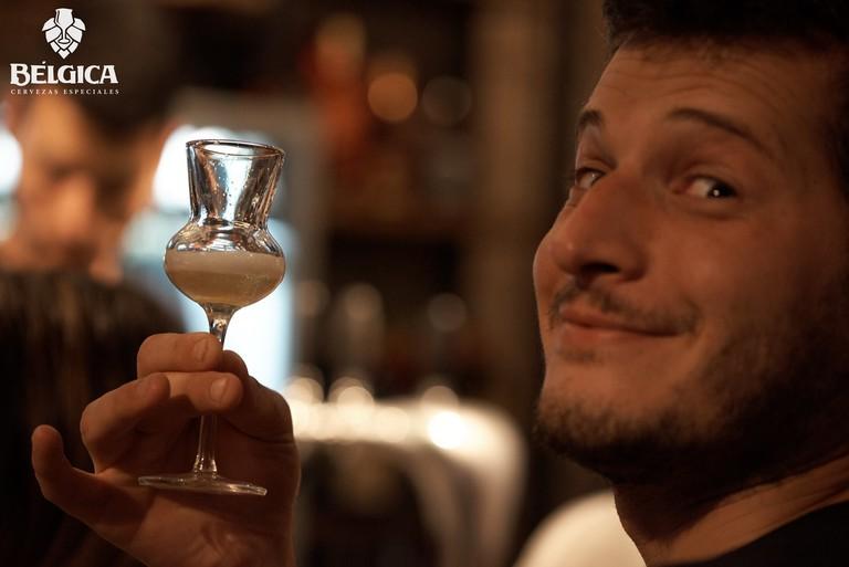 A customer enjoying a taster at Bélgica Caballito