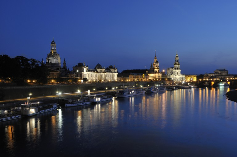 Dresden's Brühlsche Terrasse, with silhouette of the Kunstakademie, Frauenkirche and Cathedral at night