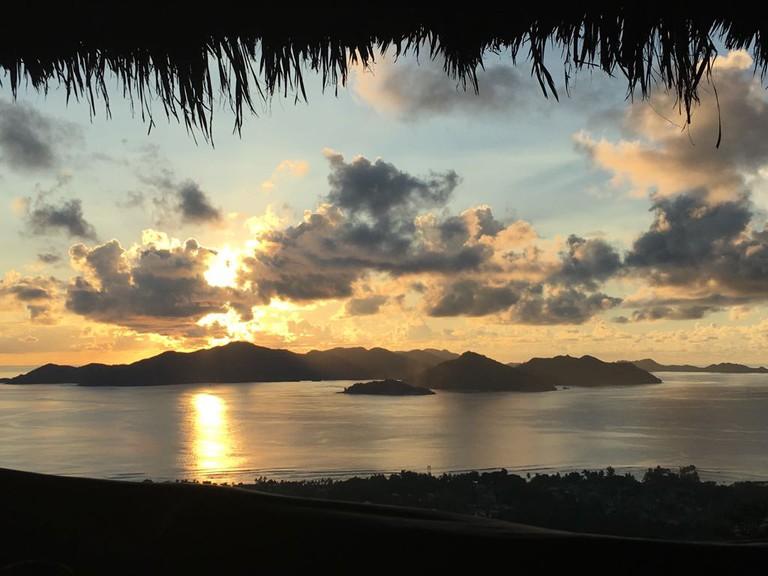 Watching the sun set over Praslin Islandat Eagles Nest