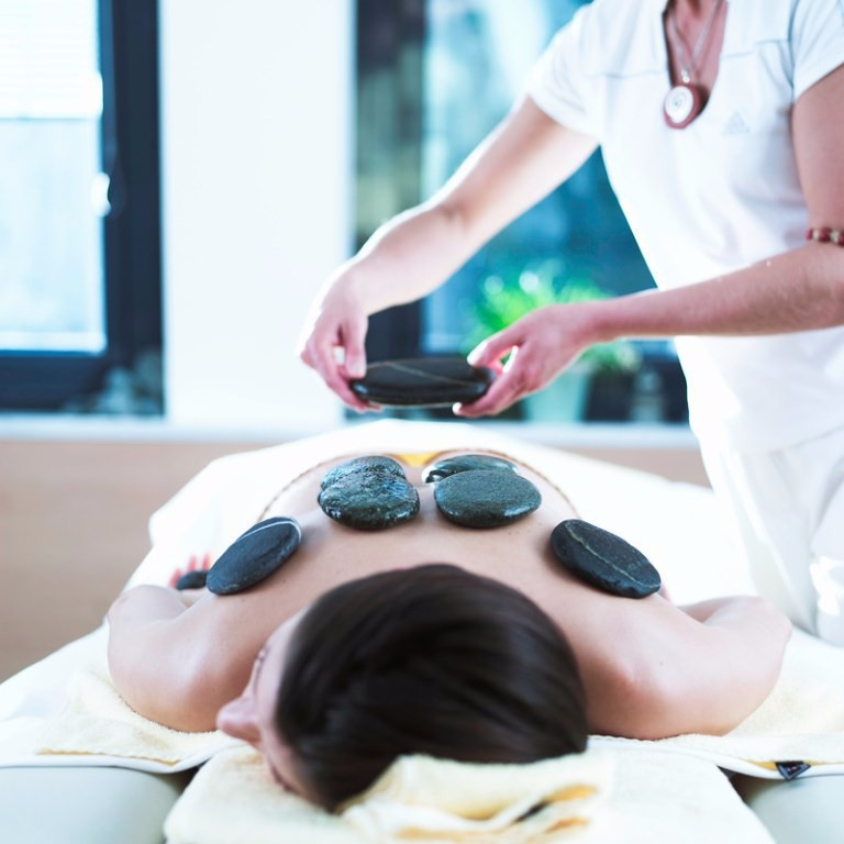 Enjoy a stone massage after your sauna experience