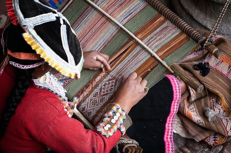 Woman making Peruvian textile