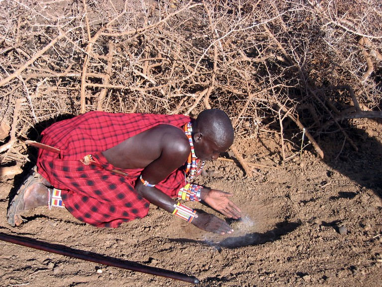 Massai preparing to make fire