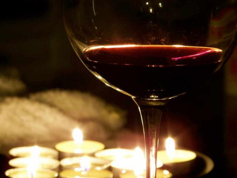 A glass of wine in the candle light
