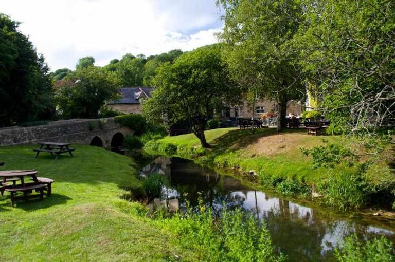 The idyllic riverside garden of The White Hart pub, Ford