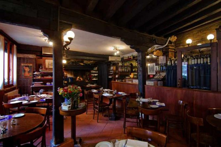 The atmosphere at Ristorante ai Barbacani is romantic and enchanting