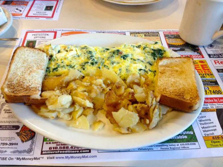 Diner breakfast: Spinach and cheese omelette, home fries and toast