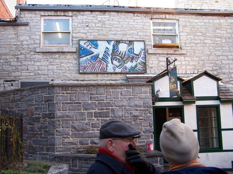 Painting by John Climenhage outside the Toucan Pub
