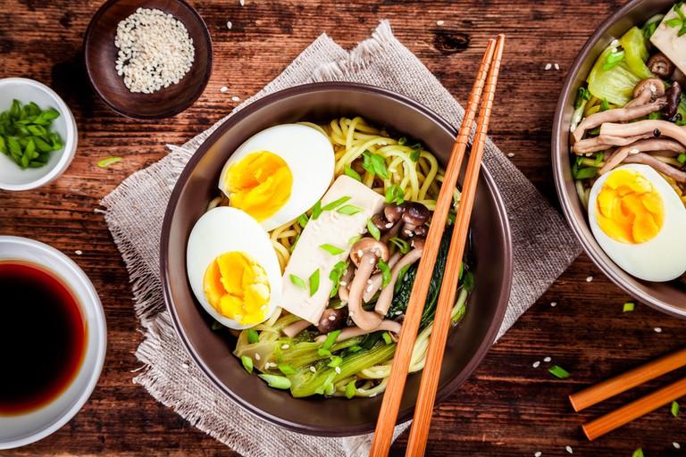 Asian miso ramen noodles with eggs, tofu and shimeji mushrooms