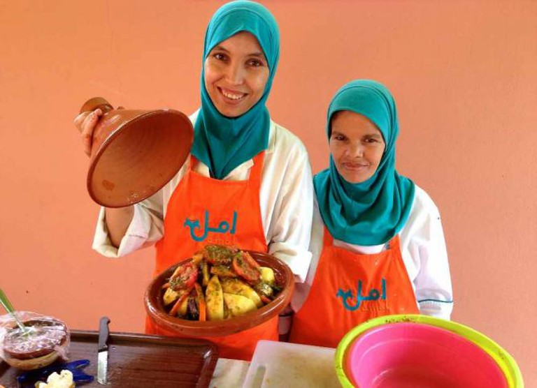 Two women working at Amal