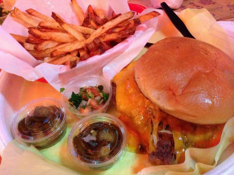 The Chris Madrid's Macho Cheese Burger with fries and sides