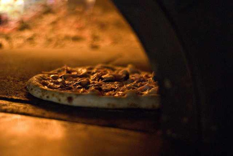 Pizza Baking in Wood Burning Oven