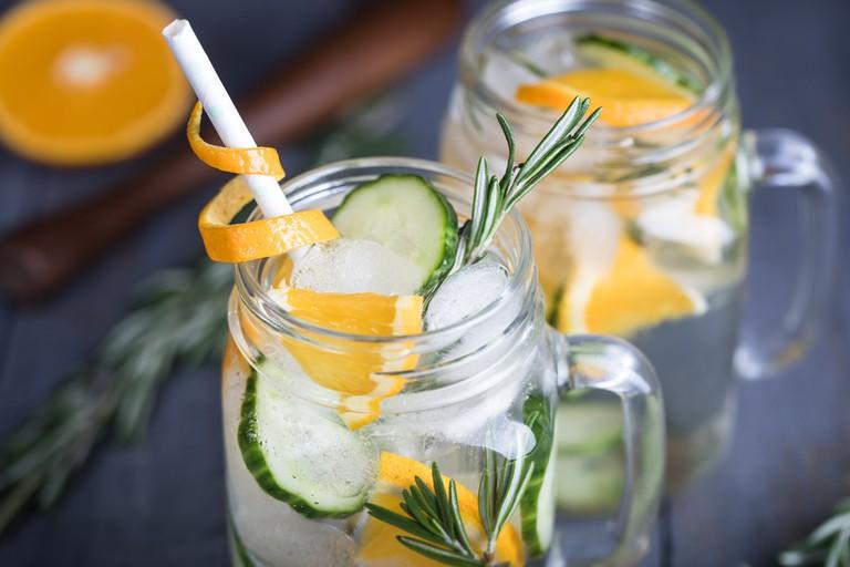 Homemade orange lemonade with cucumber and rosemary