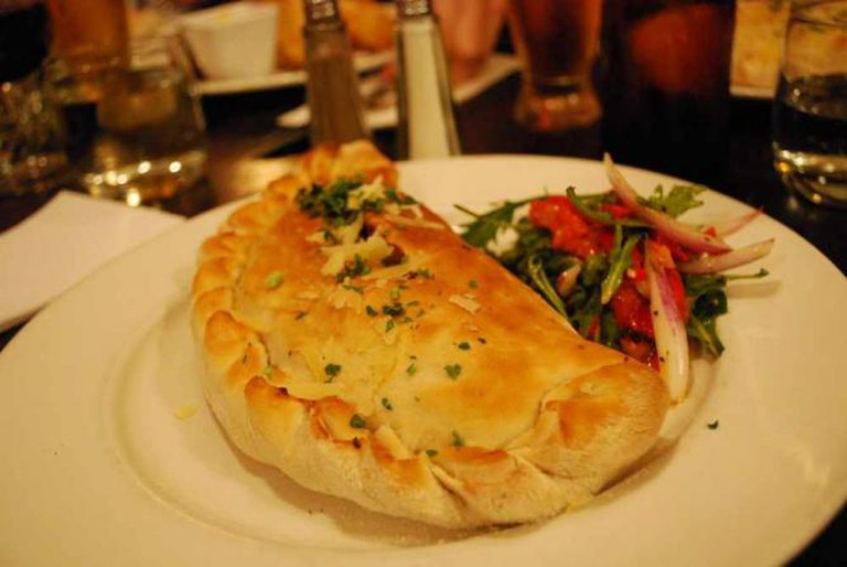 Calzone with salami, roasted tomatoes, capsicum, spinach