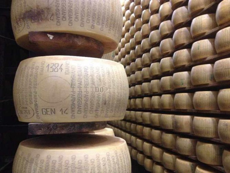 Unapproved Parmigiano-Reggiano wheel on shelf