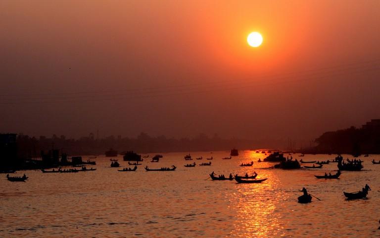Boats crossing the Buriganga River