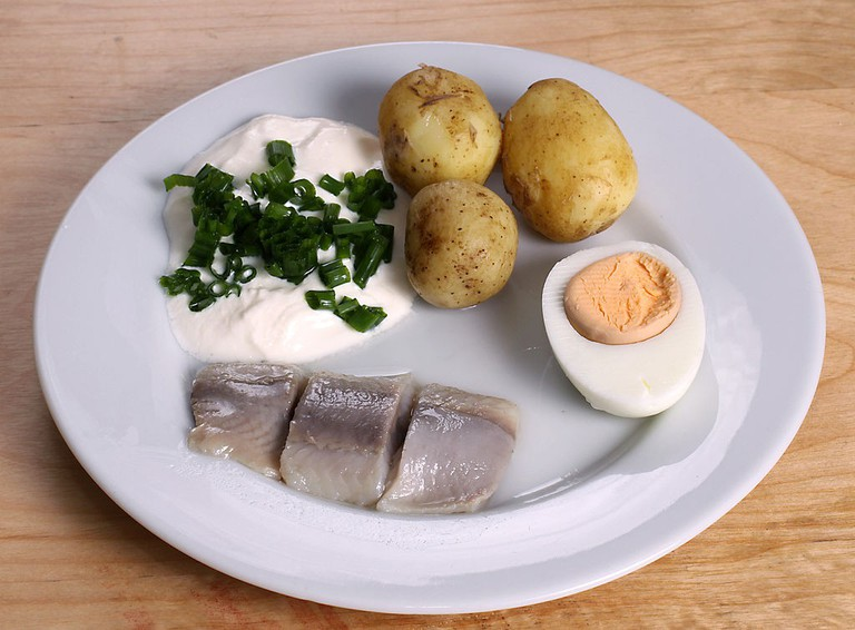 Pickled Herring Sour Cream and Chopped Chives Potatoes and Egg