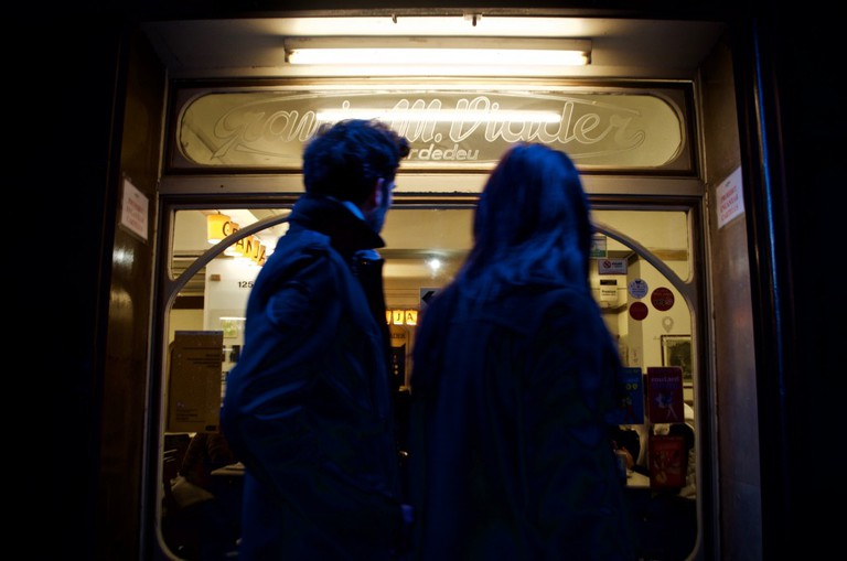 A couple couldn't resist looking inside the fabled cafe