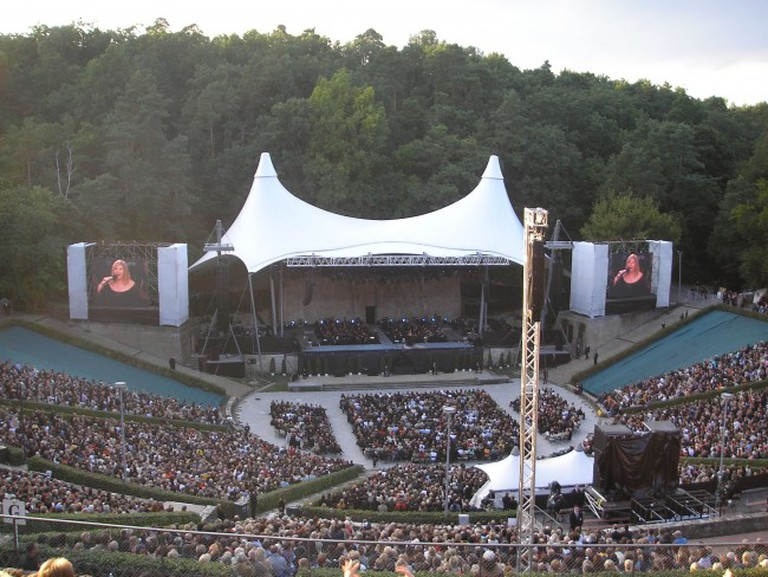 It's a special rock show that takes place in the middle of a forest