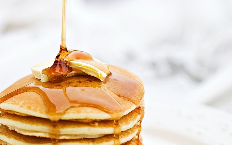 A stack of pancakes with syrup