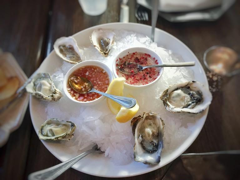 Kumamoto and malpeque oysters, g.p. pink peppercorn and yuzukosho