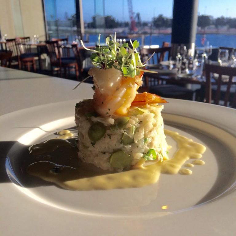 Mandurah blue manna crab and pea risotto with garlic prawns