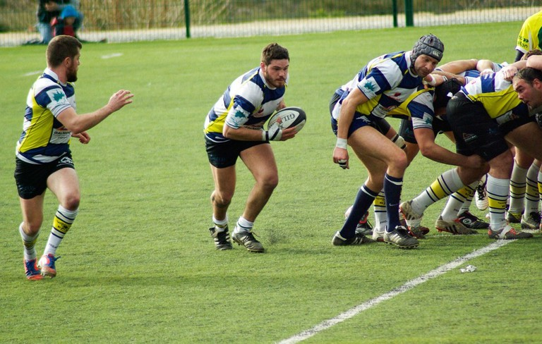 Rugby ball coming out of the scrum