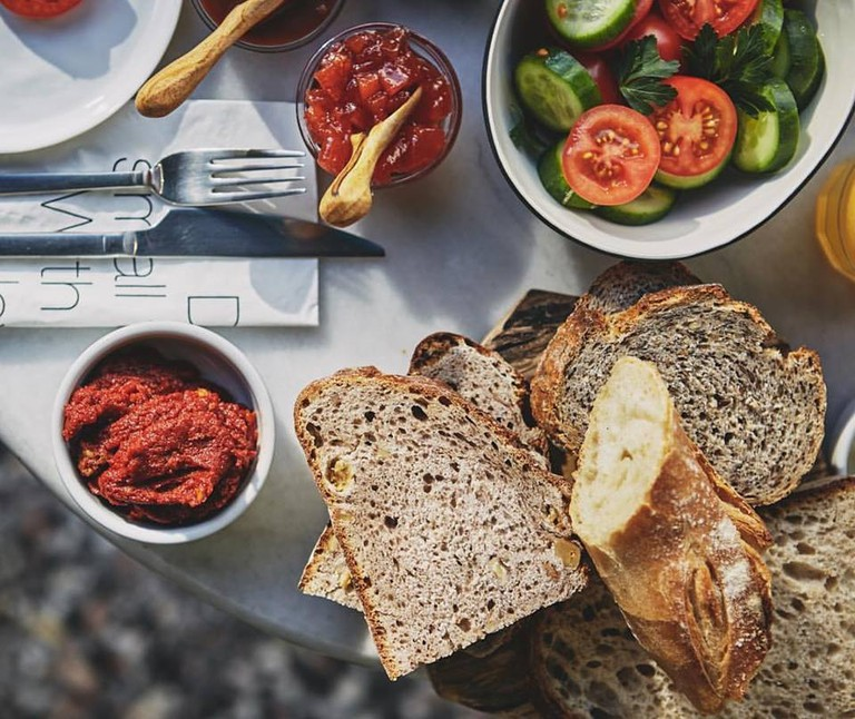 Naan Bakeshop's delicious artisan bread and some fresh accompaniments   © Naan Bakeshop