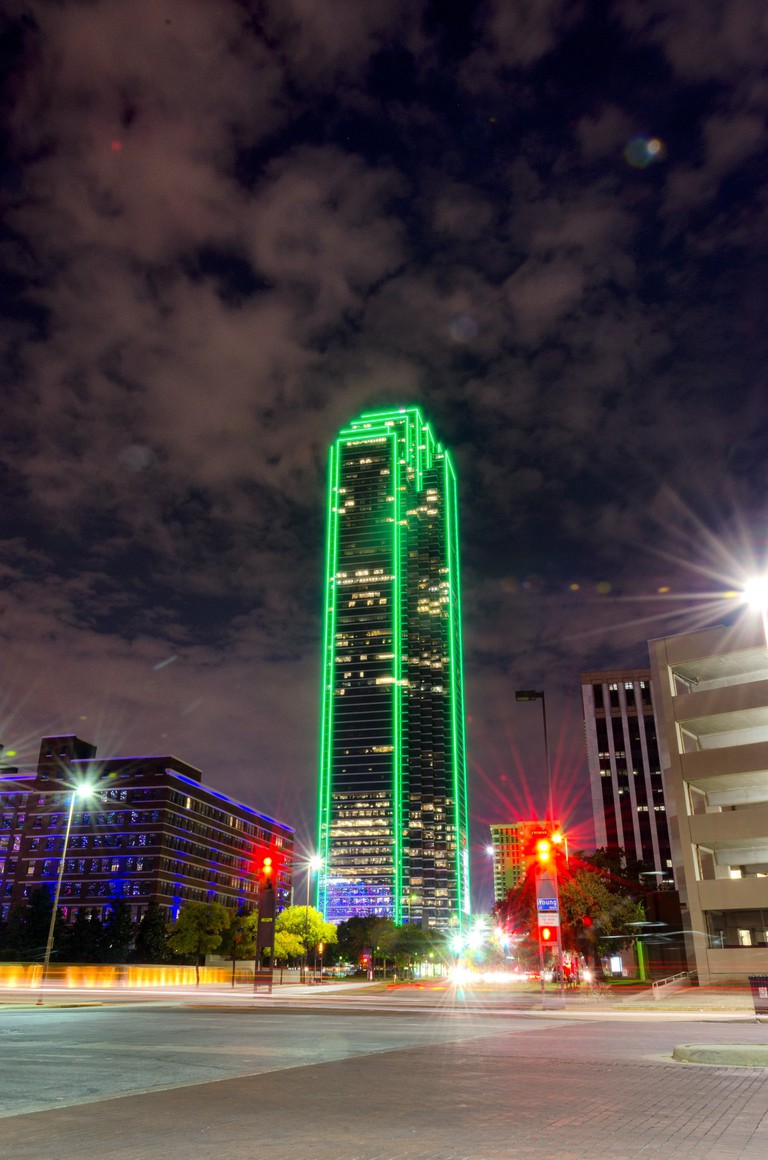 Bank of America Plaza building glows green at night