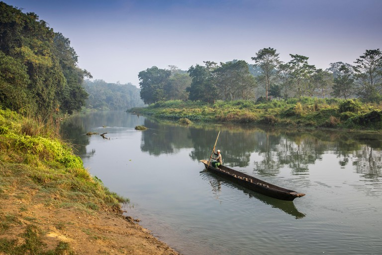 Early morning canoeing on the Narayani Rapti River in Chitwan National Park, Nepal