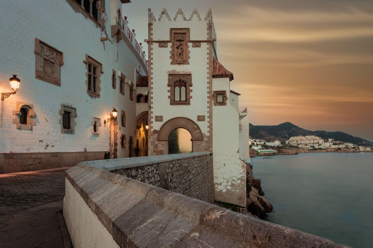 Medieval Buildings in Sitges, Catalonia, Spain with soft sunset sky at dusk