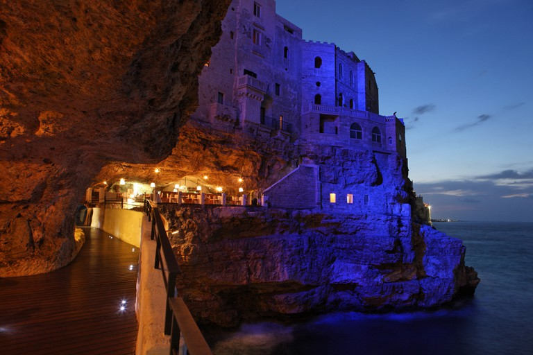 Italy Europe Polignano Province of Bari Apulia region Coast Sea Water Shore Dusk Night Evening Mediterrane