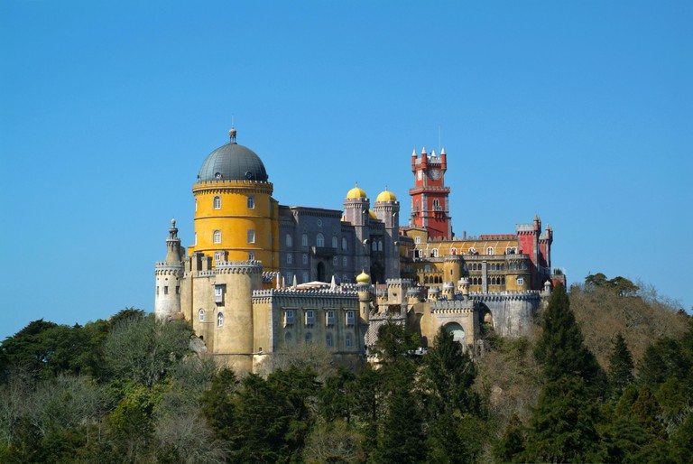 Palacio da Pena Sintra is set high on a wooded hill and framed by folly-dotted botanical gardens